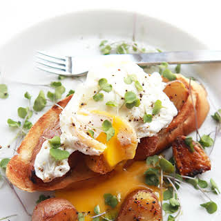 Poached Eggs over Potatoes.