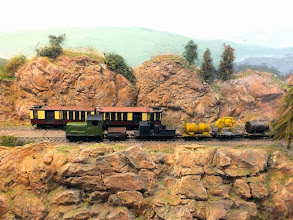 Photo: 017 A PW Dept train passes a railcar set, built by Jim Hurley, on the upper level of the mountain section .