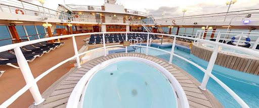 Adonia-Unwind-Crystal-Pool.jpg - Unwind on sea days at the Crystal Pool on Adonia from Fathom cruise line.
