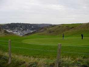 Photo: A look back towards town, showing part of the golf course just behind the cliffs – a real links course, and what elevation changes!