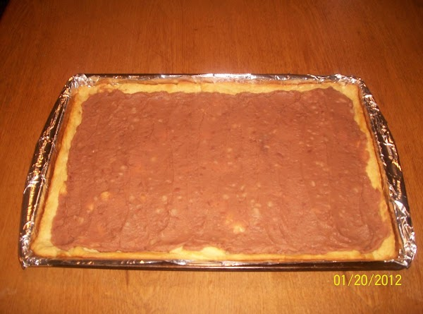 Spread the refried beans over crust in a thin layer.  Top with the...