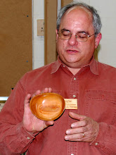 Photo: Mark Verna shows the inside of his natural edge cherry bowl.