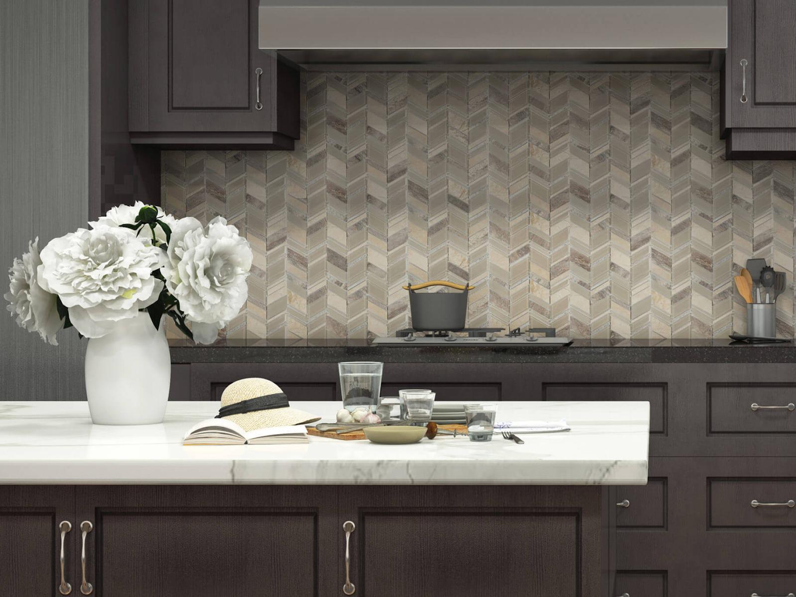 Chevron tile mosaic backsplash in light neutral tones
