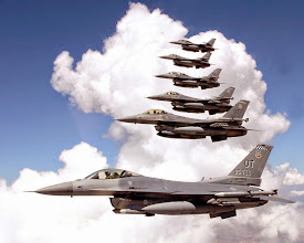 Photo: OVER CALIFORNIA -- Six F-16 Fighting Falcons fly in formation during combined developmental and operational testing of the M4.2-plus core avionics suite upgrade to the aircraft.  The formation consists of operational test aircraft from Eglin Air Force Base, Fla., and developmental test aircraft from Edwards AFB, Calif.  (U.S. Air Force photo by Tom Reynolds)
