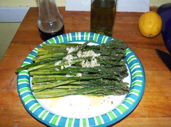 Bend an asparagus stalk til it breaks and then line it up with the...