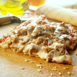 Cheesy Sausage and Mushroom Pizza.