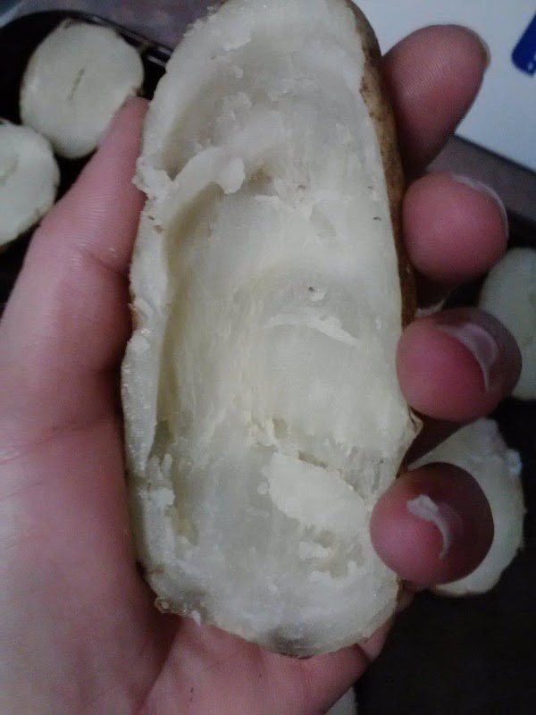 Holding cooled potato half in hand as picture shows (making sure you're supporting the...