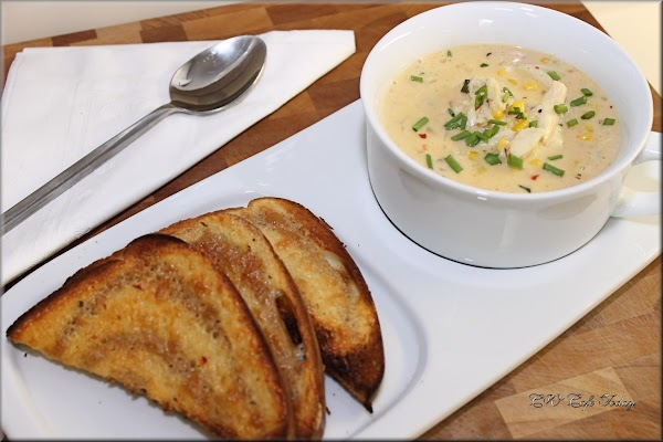 Add the crabmeat to that chowder !  Add crabmeat and be careful not to break...