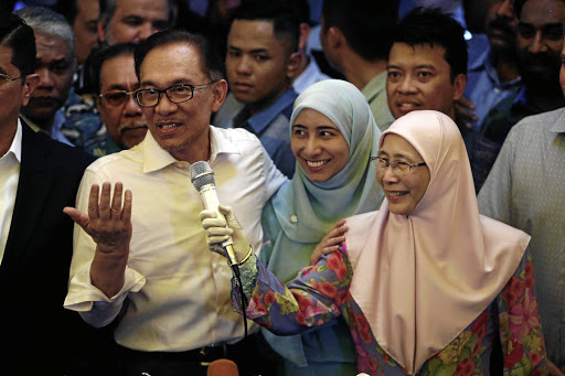 Malaysian politician Anwar Ibrahim addresses a news conference with his wife Wan Azizah Wan Ismail, right, and daughter, in Kuala Lumpur, Malaysia, on May 16 2018. Picture: REUTERS