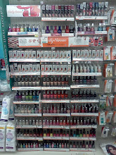 Photo: I walked down the beauty aisle and spotted this Sally Hansen display of nail polishes, I am obsessed with nail polishes so I had to admire this display. I'd love this in my room!