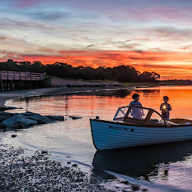Two Boys Waiting in Power Boat by Carl Albro - Transportation Boats ( dusk, sunset, beach, boys, people, boat )