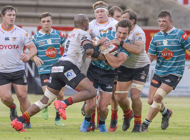 Andre Swarts of Griquas tackled by Andisa Ntsila and Jeandré Rudolph of Cheetahs during the Carling Currie Cup match between Tafel Lager Griquas and Toyota Cheetahs at Tafel Lager Park on January 09, 2021 in Kimberley, South Africa.