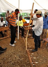 Photo: Farmers making a marker for rice transplanting in Ferrier, Haiti, June 2010 [Photo by Erika Styger]