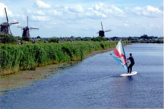 Photo: This fellow was enjoying sailboarding on the canal in the afternoon.