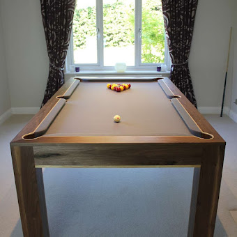 The Refined Pool Table in Front of a Window