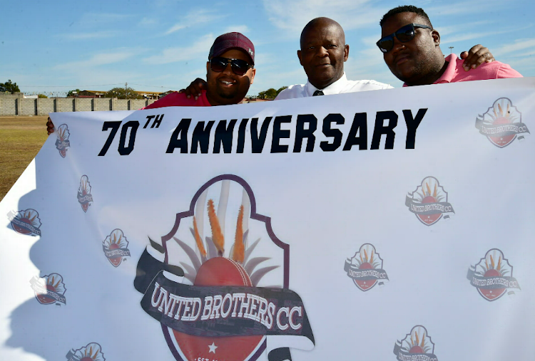 United Brothers Cricket Club officials, manager Vusumzi Gonya, left, and organiser Siyabonga Selani, will celebrate with club legend Vusani Pamba on Saturday