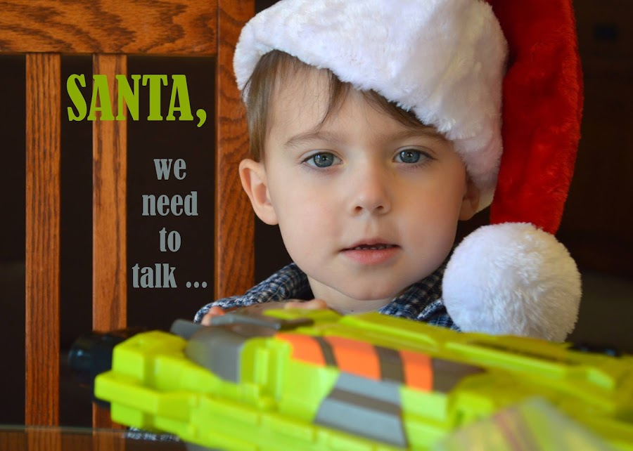 Santa, we need to talk ... by Shannon Maltbie-Davis - Typography Captioned Photos ( child, chair, red, nerf gun, santa, green, christmas, caption, santa hat, typography, boy, gun,  )