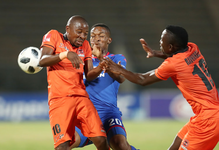 Puleng Tlolane and Ndivhuwo Ravhuhali of Polokwane City challenged by Grant Kekana of Supersport United during the Absa Premiership 2017/18 match between Supersport United and Polokwane City at Lucas Moripe Stadium, Atteridgeville South Africa on 23 January 2018.