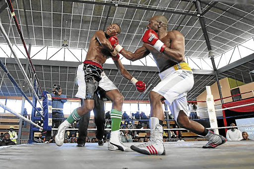 Balima Weliya, seen smashing Masixole Botile with a right cross several years ago, is a DRC Congo national who, according to the Boxing SA rules, is not entitled to fight for local titles. /MARK ANDREWS