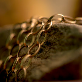 Chaining the rock by Darrell Evans - Artistic Objects Jewelry ( hanging, loops, chain, metal, stone, rock, gold )