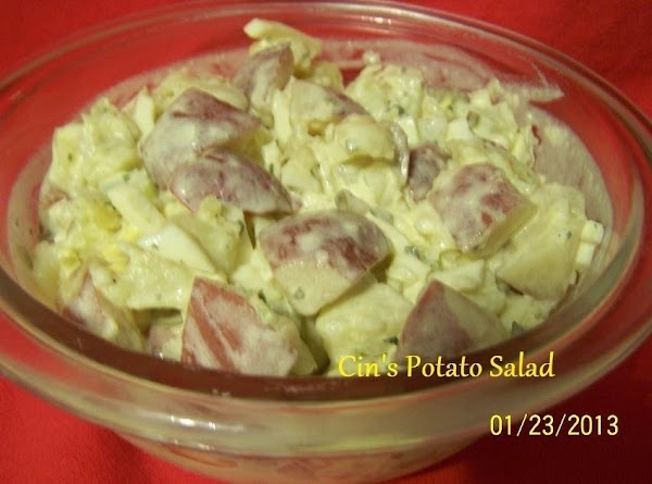 When potatoes and eggs are ready...cut, cube, dice or chop them up.  In a serving...