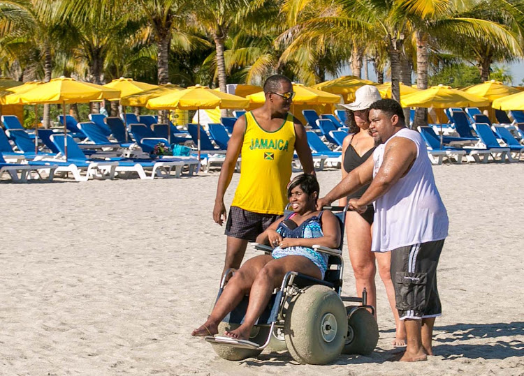 Using a beach-accessible wheelchair at Harvest Caye in Belize.