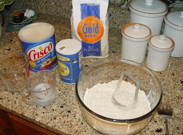 With a hand chopper, cut the Crisco into the flour and salt (using a...