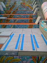 Photo: Detail of landing between the first and second flights of steps (from top) of the Hidden Garden Steps (16th Avenue, between Kirkham and Lawton streets in San Francisco's Inner Sunset District) as KZ Tile workers begin installing tread tiles on October 30, 2013 while continuing with installation of the 148-step ceramic-tile mosaic designed and created by project artists Aileen Barr and Colette Crutcher. For more information about this volunteer-driven community-based project supported by the San Francisco Parks Alliance, the San Francisco Department of Public Works Street Parks Program, and hundreds of individual donors, please visit our website at http://hiddengardensteps.org.