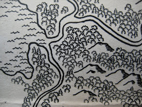 "Photo: This is a very detailed and ""busy"" map. There is no shading or coloring, only ink lines. The mountains get their texture from hatching, and the forests get (tiny) trees of several styles. Standing bodies of water have wave glyphs near the shoreline, which I found does just as much to ""pop"" the coasts out as does an ink wash."