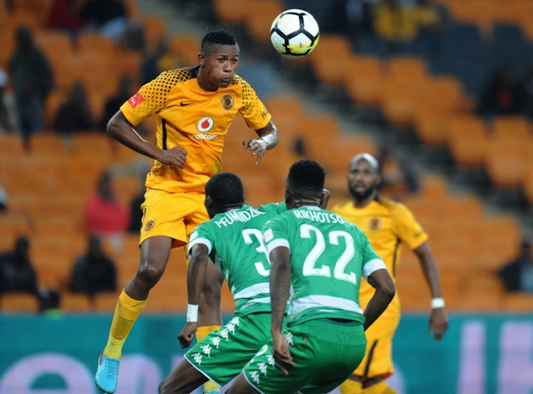 Siyabonga Ngezana of Chiefs in action with Tshepo Rikhotso and Ronald Pfumbidzai of Celtics during the Absa Premiership match between Kaizer Chiefs and Bloemfontein Celtic at FNB Stadium on February 24, 2018 in Johannesburg.