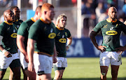 South Africa's Faf de Klerk (C) and teammates react at the end of the Rugby Championship match at Malvinas Argentinas Stadium in Mendoza on August 25, 2018.