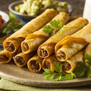 Baked Beef and Bean Taquitos with Avocado Sauce.