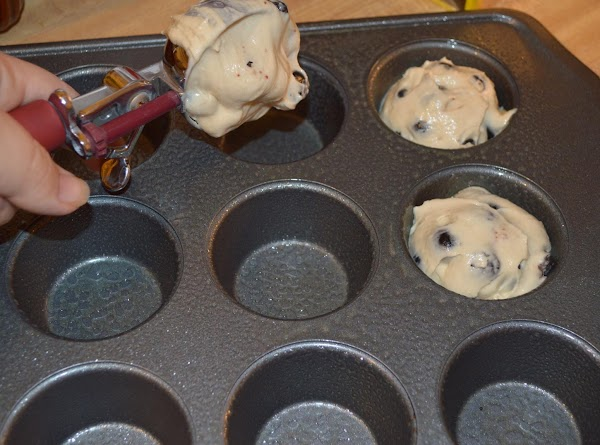 Place paper cups in the muffin pans, if no paper cups, grease tin pan...