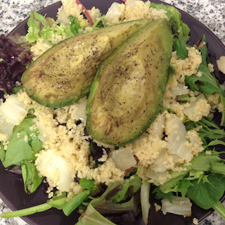 Roasted Avocado with Couscous & Mixed Greens.