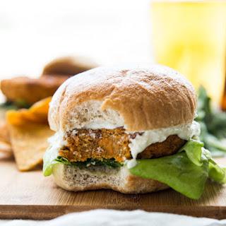 Buffalo Chickpea Sweet Potato Burgers with Whipped Feta Garlic Sauce