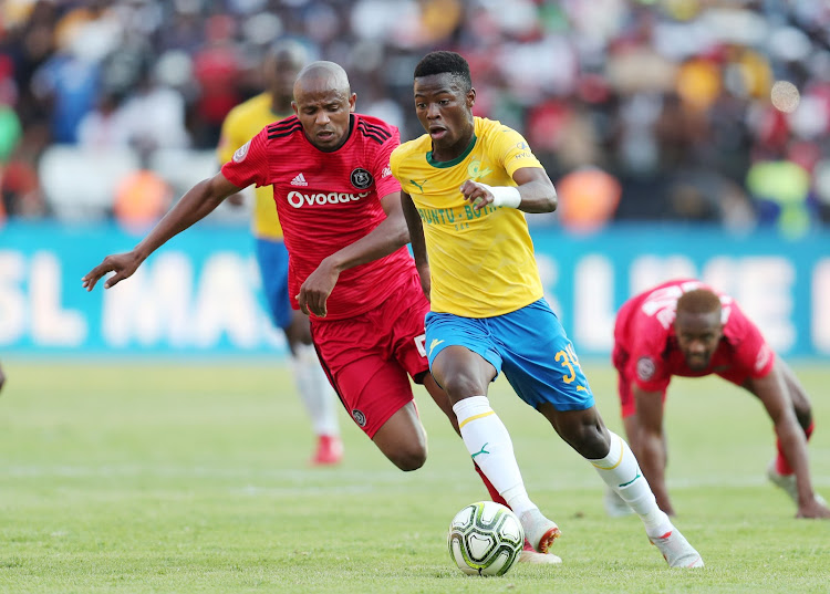 Phakamani Mahlambi of Mamelodi Sundowns challenged by Xola Mlambo of Orlando Pirates during the Absa Premiership 2018/19 match between Mamelodi Sundowns and Orlando Pirates at the Loftus Versveld Stadium, Pretoria on 10 November 2018.