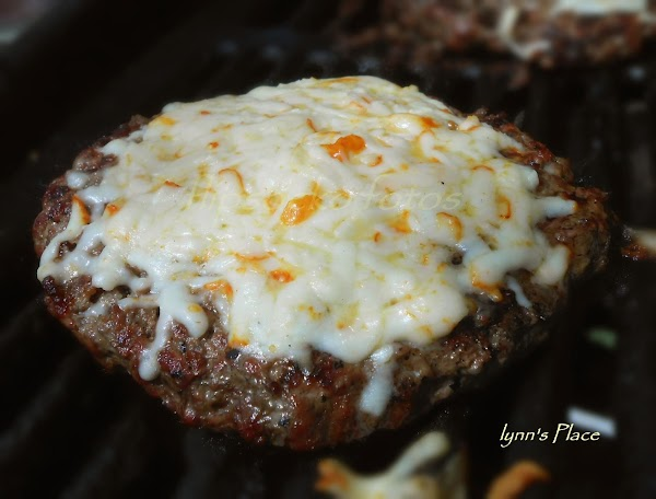 Grill burger to your liking.  Add cheese as soon as you flip your...