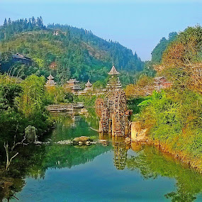 by Alvin Ngow - Instagram & Mobile Other ( reflection, houses, mountain, park, waterwheel, guizhou china, lake, travel, waterscapes, photography, yangshuo, tree, nature, background, outdoor, historic town, guizhou, tourist attractions, scenery, guilin, landscapes, garden, river, china,  )