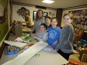 Photo: The D'Eon Family - Lisa, Robert, Eric, Chloe & Ava wrapping gifts for the kidz!