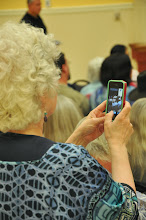 Photo: Esther Altshul Helfgott takes a picture.
