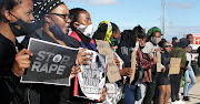 Members of the Nelson Mandela Bay  LGBTQI+ community  protest at the  KwaDwesi police where a rape complaint was  laid against a Port Elizabeth pastor