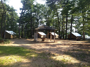 Photo: Pavilion tent area. The tents won't be up during our rental, but we can use the pavilions for those who want to pitch tents.