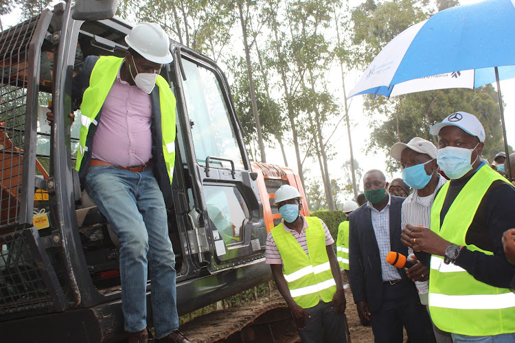 Agriculture CS Peter Munya alights from an excavator during the groundbreaking of the Aguthi-Ndiriti Irrigation project in Nyeri on Saturday