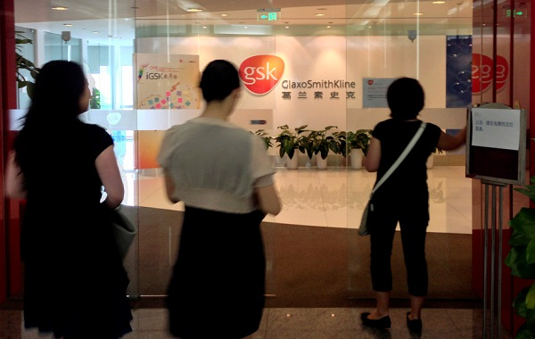 Chinese employees walk into a GlaxoSmithKline office in Beijing. File photo:REUTERS