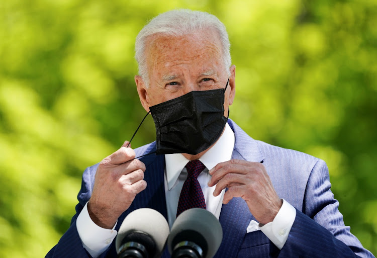 US President Joe Biden removes his face mask as he delivers remarks on the administration's Covid-19 response outside the White House in Washington, US, on April 27 2021.