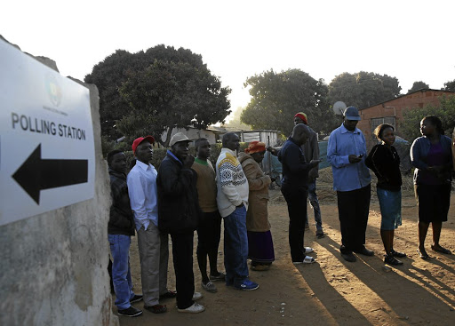 Changing times: People queue to vote in Kwekwe in Zimbabwe in the July 30 election. Investors are warming to Zimbabwe while keeping an eye on the political situation. Picture: REUTERS