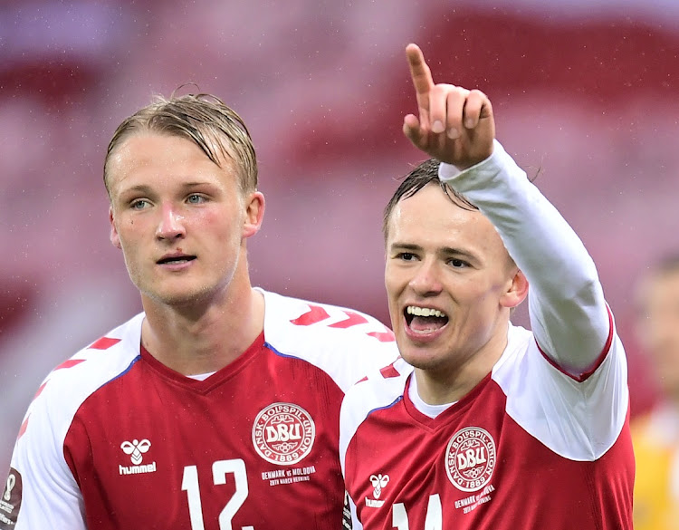 Denmark's Mikkel Damsgaard celebrates scoring a goal with teammate Ritzau Scanpix in the World Cup Qualifier against Moldova at MCH-Arena, Herning, Denmark on March 28, 2021