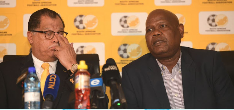 SA Football Association former acting CEO Gay Mokoena (R) with President Danny Jordaan (L) at a media briefing in Johannesburg on March 18 2020. Mokoena, a high-ranking member of the high-decision making Safa Council, accuses his President of flouting corporate governnance protocols at the Association.