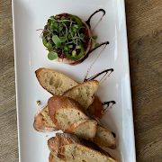 Chili Garlic Lingonberry Baked Brie