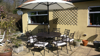 Photo: http://www.outsideedgegardenfurniture.co.uk/Cast-Aluminium-and-Metal-Garden-Furniture/Tables-for-8/Round-8-Seater-Garden-Furniture-Set.html